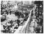 The Berlin Wall being erected by East German workers in 1961