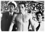 A bloodied Hungarian water polo player is escorted from the pool in Melbourne, 1956