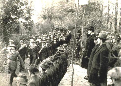 Members of the IRA parade before their leader, Eamon de Valera, in 1922